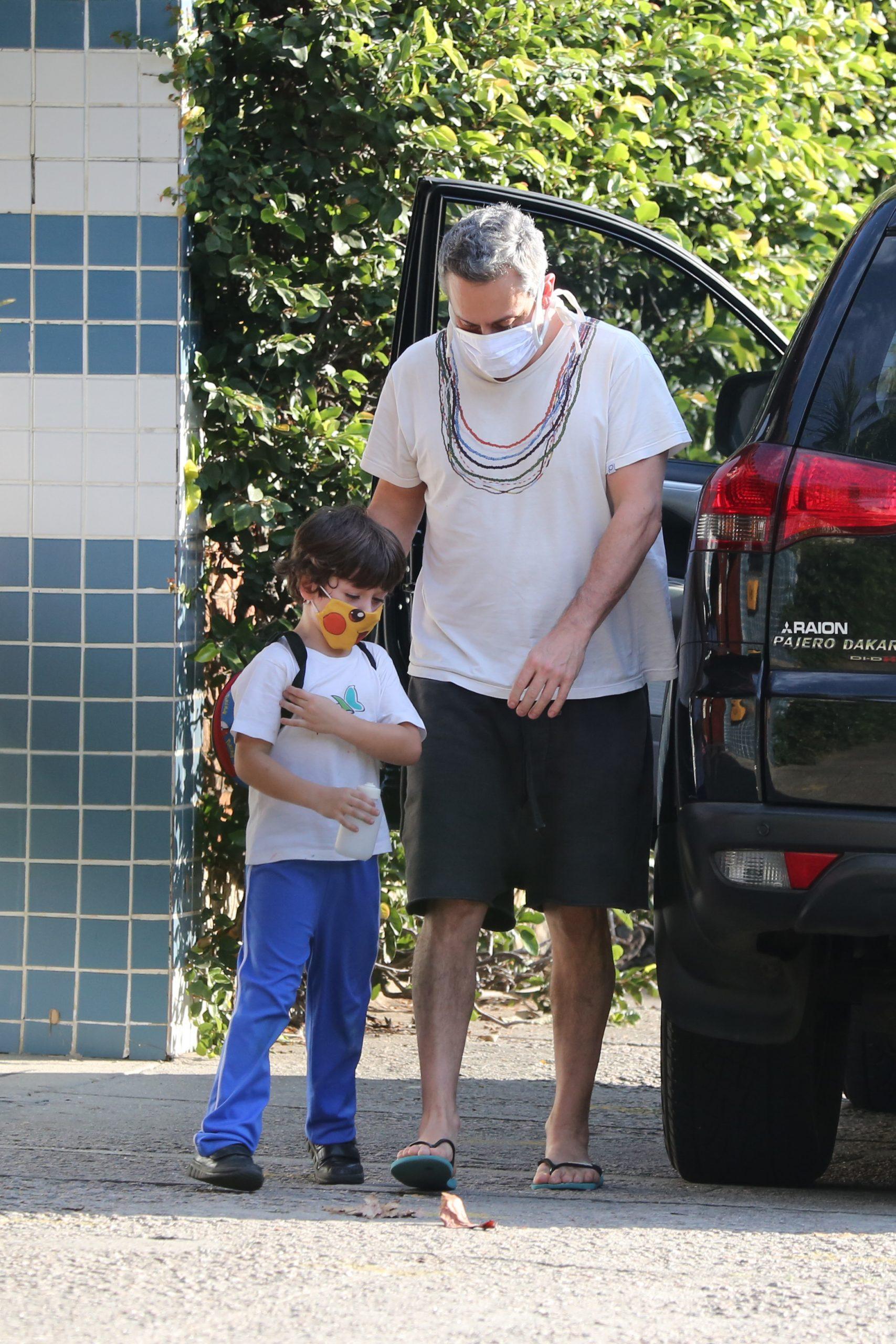 Em clique raro, Alexandre Nero busca o filho na escola